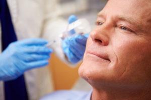 Man receiving Botox to improve smile